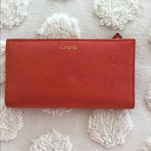Lodis coral leather wallet and card carrier.